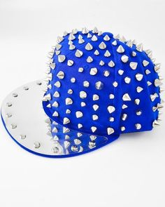 42d44cb731e Unisex   Rhodiumized   Silver Spike Ccb (bead) On Blue Fabric   Polyester