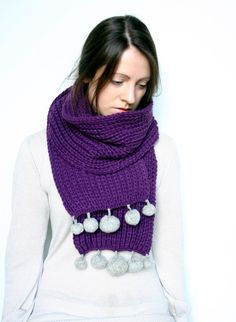 A scarf would look cool with knitted leaves instead of pom poms at the edge.