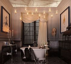 Inspired by the latest film adaptation of Anna Karenina, this gorgeous bathroom starts off dark and moody and transitions to a lighter, brilliant hue, which naturally draws the eye upward. (Photo Credit: Regina Sturrock Design for DXV)