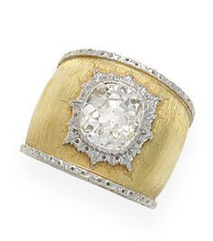 A diamond dress ring, by Buccellati The wide textured band set with a cushion-shaped diamond in a raised collet, diamond approximately 3.60 carats, signed M.Buccellati, maker's case