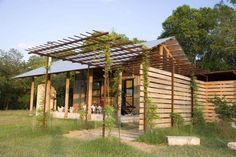 Texas architect Trey Rabke reimagines his family's country getaway, tying the design firmly to the land around it Stone Porches, Lake Flato, Texas Farmhouse, Built In Storage, Small Storage, Steel Pergola, Porch Roof, Sleeping Loft, Italian Garden