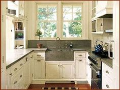 kitchen remodel idea - i love the sink and the open shelves above the bar