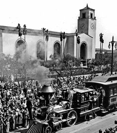"""The """"C.P. Huntington,"""" California's first locomotive, pulls up in front of the brand-new Union Station during an opening day parade held on May 3, 1939. This photo was published in the May 4, 1939, issue of the Los Angeles Times."""