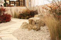 """Garden Exposition at Expocasa 2014, a """"winter walk"""" in a garden coloured by Nandina Domestica, Nandina Fire Power, Cornus Sibirica, Betula Utilis Jacquemontii and Stipa Tenuissima."""