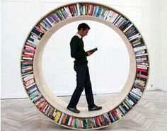 Take your library with you wherever you go if you have a hamster-wheel bookshelf! [Circular walking bookcase designed by David Garcia. Creative Bookshelves, Bookshelf Design, Round Bookshelf, Bookshelf Ideas, Best Bookshelves, Bookshelves Online, Tree Bookshelf, Round Shelf, Shelving Design