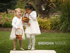 Flower girls with colourful fall leaves instead of flower petals for a great fall wedding touch!
