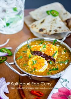 A spicy, flavorful, and easy Indian Egg Curry with hard boiled eggs cooked in aromatic Indian spices and coconut. This simple egg curry is THE best way to serve Indian Dinner under 25 minutes!Be a...