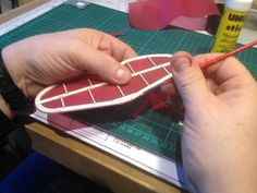 Learn how to apply tissue covering to your balsa model with our illustrated guide