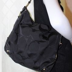 NWOT Coach Black Shoulder Bag Never been worn and in perfect condition coach shoulder bag in black. Great holiday purse and gift! A simple black designed bag to always have. The signature Carly bag. Medium bag. Coach Bags Shoulder Bags