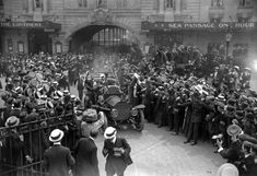 25th July 1909: Crowds cheer French aviation pioneer Louis Bleriot (left, waving) at Victoria station, London, after his historic Channel flight. Seated next to Bleriot is the 1st Viscount Northcliffe, the Daily Mail publisher, who organised the Channel Challenge. (Photo by Topical Press Agency/Getty Images)
