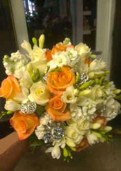 Bright fall inspired orange pastels in this wedding bouquet. Good Luck to the happy couple! americasflorist.com