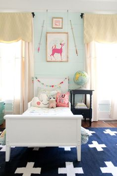 Nice girl's room - sweet but not too frilly.  Love the pale aqua wall with the animal print + arrows.