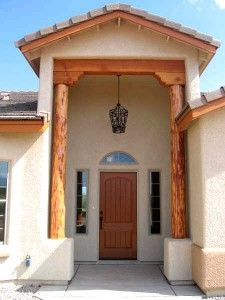 My sister is in the process of building her dream home, but she still has some designs to cover. I think that a entryway like the one in this picture would be absolutely perfect for her. It acts as such a nice focal point for the exterior of the home.