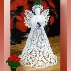 Ravelry: 0311 Pineapple Cascade Angel pattern by Cylinda D.Crochet pattern for a thread pineapple angel Add to WishlistThis week's Friday Feature, Cylinda Matthews, comes to you from Crochet Memories!Crochet patterns for each of the holidays Crochet Christmas Trees, Crochet Christmas Ornaments, Christmas Crochet Patterns, Crochet Snowflakes, Christmas Tree Toppers, Christmas Angels, Merry Christmas, Snowflake Ornaments, Crochet Ideas