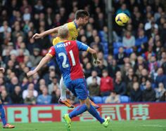 Olivier Giroud takes flight to head home the second goal for Arsenal against Crystal Palace. 2-0.