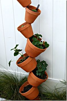 diy vertical garden.  neat! my hubby is going to attempt to make me one of these but with stuff on hand not store bought.