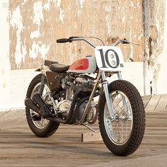 BSA A65 Trackmaster; almost passed this one by, as I tend to shy away from pure race bikes...then I saw the headlights blending into the Number Plate!  Yes..this is street legal!  Not bereft of Flat Track queues though; Borrani Rims, rear only brake, and of course, Vintage BSA Power.