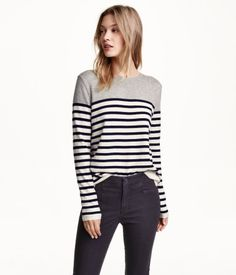 Fine-knit sweater in a cotton blend with alpaca content. Slits at sides.
