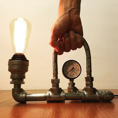 KIANG BABY This industrial style lamp is handmade from water pipe and pressure gauge. Bulb NOT included in purchase. Kiang Baby products are designed, handcrafted and assembled in Taipei, Taiwan. Materials:iron, stainless steel, pipe, PVC, cord, bulb socket, switch, pressure gauge, tube