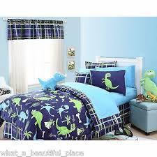 DInosaur Bedding for dinosaur room! LOVE the colors! Toddler Bed Comforter, Toddler Bed Sheets, Twin Comforter Sets, Bedding Sets, Plaid Comforter, Dinosaur Crib Bedding, Dinosaur Bedroom, Boy Room, Kids Bedroom
