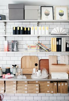 Scandinavian kitchen storage display with white subway tiles
