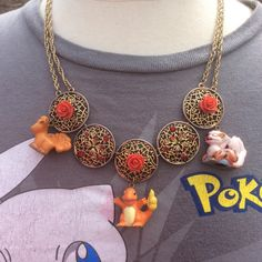 Fire Type Pokemon Necklace with Charmander, Vulpix, and Arcanine by RainbowCastle on Etsy https://www.etsy.com/listing/129085539/fire-type-pokemon-necklace-with