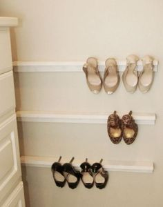 Shelves as shoe holders?! Seems so simple I wonder if they stay there... Might be worth trying!