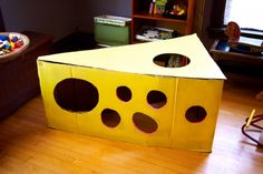 Who wouldn't enjoy a cardboard swiss cheese fort?! I think I'll make one for my cat! www.thecardboardcollective.com