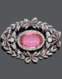 BELLE ÉPOQUE TOPAZ, RUBY AND DIAMOND BROOCH, ca. An openwork brooch set with one oval pink topaz, within a diamond surround of laurel leaves & ribbon bows; set with circular & rose-cut diamonds, and 14 small rubies; Royal Jewelry, Pink Jewelry, Gems Jewelry, Jewelery, Jewellery Box, Jewelry Gifts, Belle Epoque, Edwardian Jewelry, Antique Jewelry