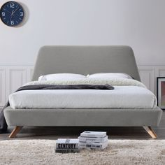 The mid-century inspired Henry upholstered platform bed will lift your mood and add the pop of color in your bedroom that you desire. The classy, yet soft frame and angled legs create a brilliant contrast and complement all furniture perfectly. Look forward to retreat any time to this work of art in its own.