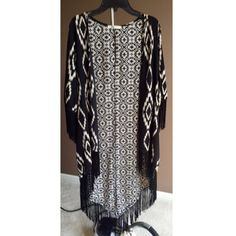 Cream & black patterned kimono ⬜️♣️ A long kimono with fringe detailing along the sleeves and bottom. Looks great dressed up over a dress, or dressed down with ripped skinny's ✨ Boutique Jackets & Coats Capes