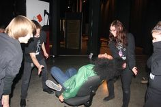 Stage crew spin lead Chelsea Kilburn around backstage before show.