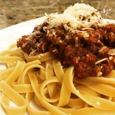 Pasta night - homemade Bolognese sauce topped with 24 month aged Parmigiano Reggiano - Instagram by ourtastytravels