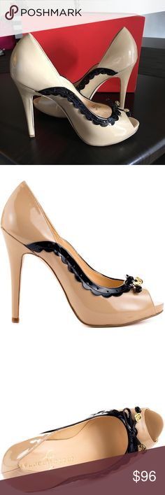 NIB Ivanka Trump Beige blk Patent platform pump 8 NIB Ivanka Trump Beige with black detail/bow Patent peep toe platform pump size 8. These shoes are approximately 3 1/2 inches high with platform. Comfy high heel. Bottom is slightly dirty from trying on but you can see from the heel they haven't been worn outside. Ivanka Trump Shoes Platforms