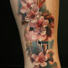 Cherry Blossom Tattoo - You can represent this tattoo in a popping array of bold pink color and delicate, paper-like leaves. The blossom tattoo symbolizes beauty and fragility of life. #TattooModels #tattoo