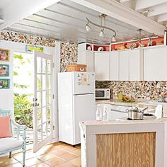 Key West Kitchen with Shell Backsplash - Key West Style Interiors and Homes - Coastal Living - I like the blue bench with white cushion and pink pillos