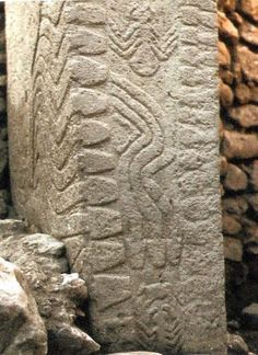 11,000 year old pillar carved possibly with flint knives at Gobekli Tepe in Turkey, first discovered in 1994