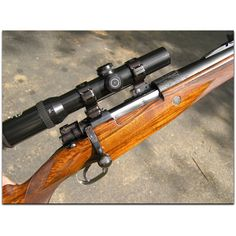 "Holland and Holland, London. Exceptionally fine ""Deluxe"" Mauser bolt action rifle chambered in .338 Win. Mag., ca. mid 1990's"