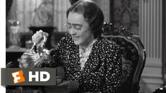 Bette Davis as an old-maid about to have a nervous breakdown in Now Voyager.  Is this what people thought single women of a certain age should look like?  Charlotte's psychiatrist helps her to break out of that mold and become her own woman.  She is transformed from crazy old-maid to drop dead gorgeous socialite and has a brief, intense affair with a married man.