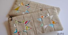 My {sew tiny} pieces have transformed into zippered pouches. The wonky star pouches have been shipped last week. After my ...