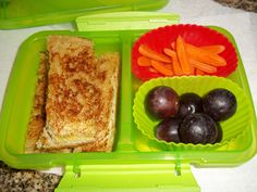 Carrots, grapes, grilled cheese sandwich.