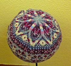 A beautiful, colourful Fair Isle Hat, knitted in the round and great for using up leftover scraps of 4 ply yarn.