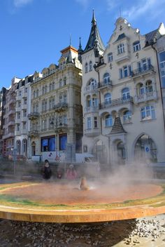 Karlovy Vary, Czech Republic - Healing mineral waters literally bubble up from the ground in this unique spa town just 2 hours from Prague.  #travel #czechrepublic #karlovyvary #spadestinations #hotsprings #beerspa