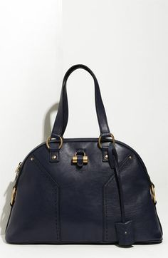 This year I treated myself to the Oversized YSL Dome Satchel.  Mine is tooled and oh so lovely!  A definite head-turner and fashionista heartstopper.