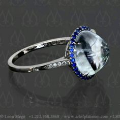 Sumptuous natural white sapphire in a circle of vivid blue sapphires. The custom made ring with a rare high domed sapphire cabochon. This ring's shank is adorned with diamond. Delicate playful filigree  basket.  See it here:  http://ift.tt/1T7KQBi  #Sapphirering #Righthandring #platinumring #cabsapphirering #Cabochonsapphire #Cabochonnesapphire #Buyjewelery #Burmasapphire #benchmadejewelry #Hand-forgedjewelry #Perfect #Wow #micropavering #Europeancraftsmanship #Eveningwear…