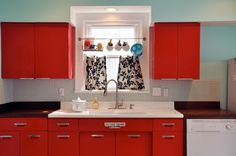 Retro kitchen. Since I will never be able to afford red appliances, this would be a good substitute. Red cabinets with black appliances and black counters.