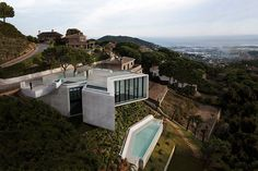 The aptly named X House, devised by architects at Cadaval & Solà-Morales, uses its quirky shape to provide privacy on a tight lot near Barcelona surrounded by neighboring dwellings. In another twist, the garage and entry level occupy the upper floor; the rest of the house, including a double-height living room, is downstairs.
