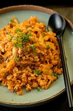 Kimchi Fried Rice - I would probably use green onion instead and save some for garnish. I also like it a little more spicy so I would add 1-2 Tbs of Korean red pepper paste and sprinkle sesame seeds on top when finished. Don't be afraid of the kimchi smell, the nappa cabbage kimchi is extremely tasty!