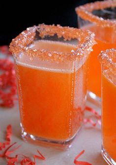 Hocus Pocus Fizz  This fizzy little adult beverage is full of magic! After all who doesn't love all things orange on Halloween? Ingredients: pineapple juice, rum, sparkling white wine, coconut extract, and red and yellow food coloring. Mix, adding food coloring to achieve orange color. Rim glasses with orange sugar, pour in drink, and serve. Halloween Punch, Halloween Treats, Halloween Cocktails, Halloween Party, Happy Halloween, Party Drinks, Fun Drinks, Yummy Drinks, Mixed Drinks