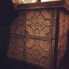 pressed tin ceiling panels bar wall.